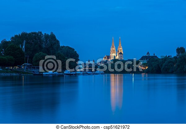 Regensburg with the yacht harbor at the danube river and view to saint peter cathedral at blue hour - csp51621972