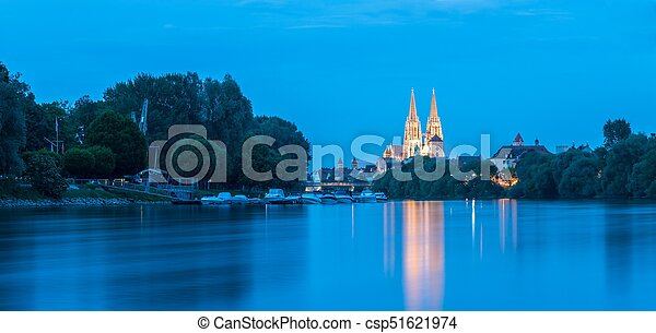 Regensburg with the yacht harbor at the danube river and view to saint peter cathedral at blue hour - csp51621974