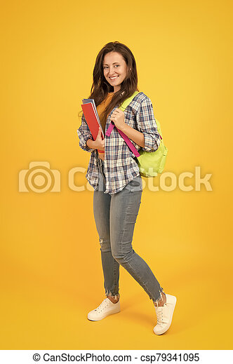 Regular student carry workbooks. Student life. School girl with backpack. Woman adult student. Final exam and graduation. Dedicated to studying. College university education. Student with backpack - csp79341095