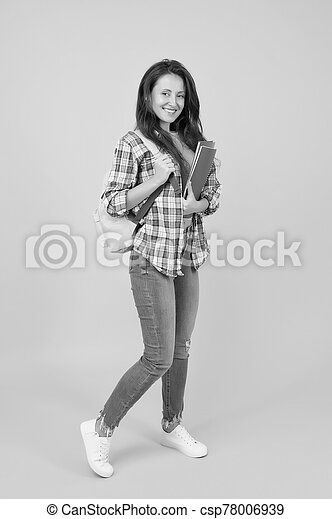 Regular student carry workbooks. Student life. School girl with backpack. Woman adult student. Final exam and graduation. Dedicated to studying. College university education. Student with backpack - csp78006939