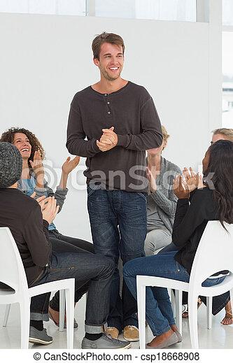 Rehab group applauding happy man st - csp18668908