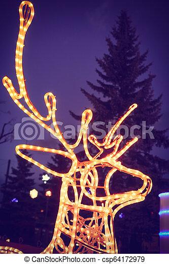 Reindeer light bulb in Christmas day - csp64172979