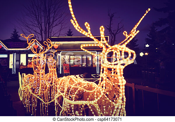 Reindeer light bulb in Christmas day - csp64173071