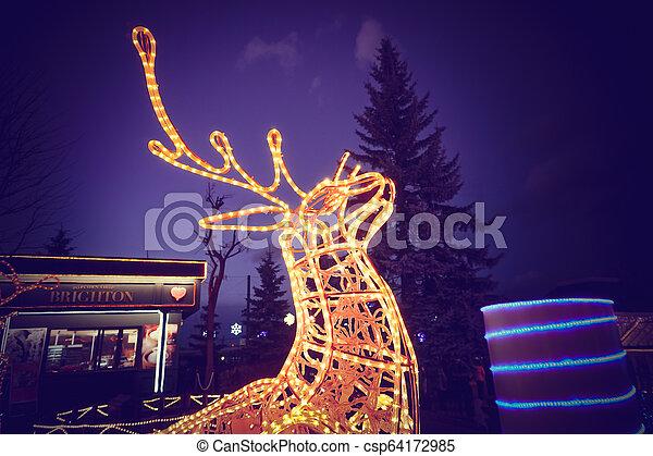 Reindeer light bulb in Christmas day - csp64172985