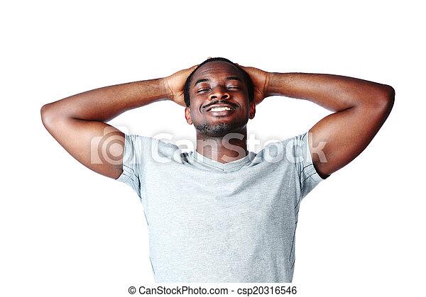 Retrato de un hombre africano relajado sobre fondo blanco - csp20316546