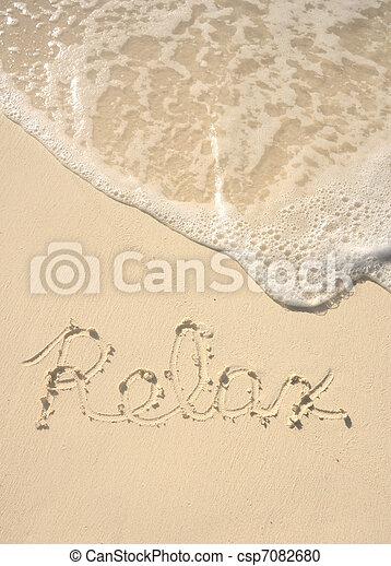 Relax Written in Sand on Beach - csp7082680