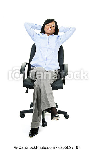 Relaxed businesswoman sitting on office chair - csp5897487