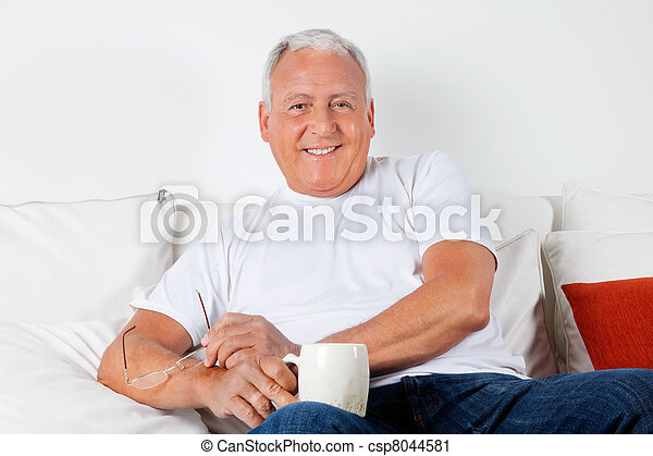 Relaxed Senior Man Having with Warm Drink - csp8044581