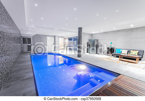 relaxing lighting. Relaxing Indoor Swimming Pool With Lighting And A Corner For Rest. Luxury Resort Beautiful Clean Blue Water Light Effects Around The J