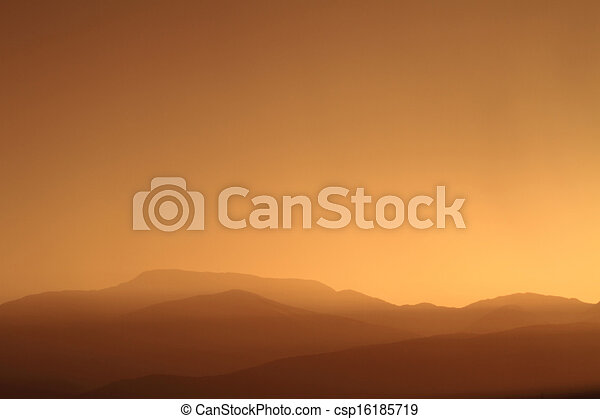 Relaxing sunset with silhouette of mountain range - csp16185719