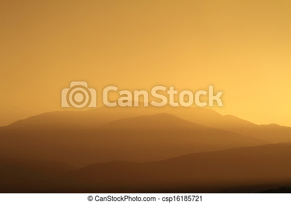 Relaxing sunset with silhouette of mountain range - csp16185721