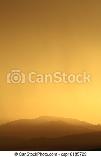 Relaxing sunset with silhouette of mountain range - csp16185723