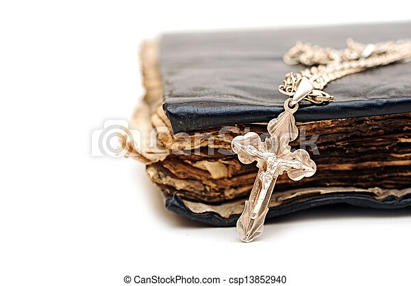 Religion. A cross with a chain against a old book - csp13852940