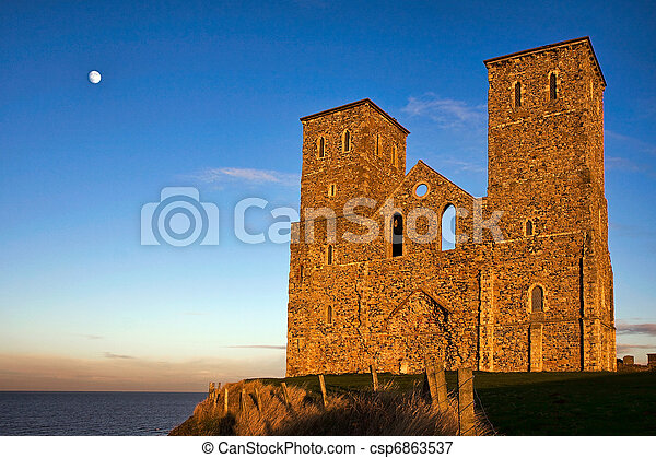 Remains of reculver church towers bathed in late afternoon ...