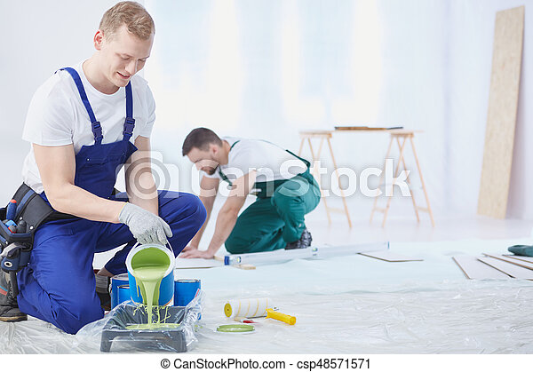 Renovation crew  mixing the paint - csp48571571