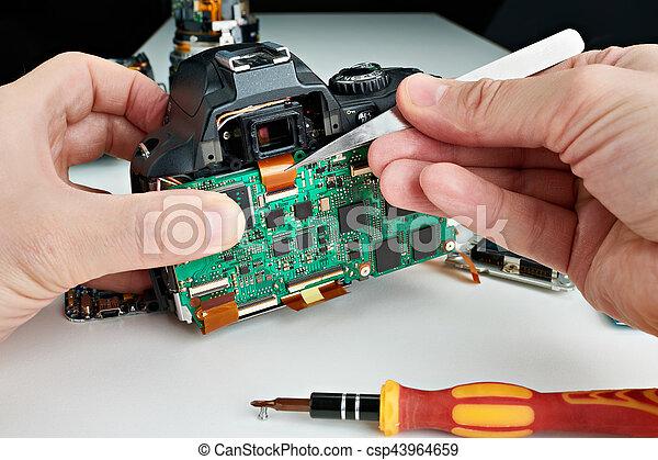 Repair broken photo DSLR camera in service - csp43964659