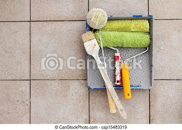 Repair tools over stone floor tile background. Copy space. - csp15483319