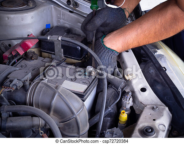 repairing an old car. - csp72720384