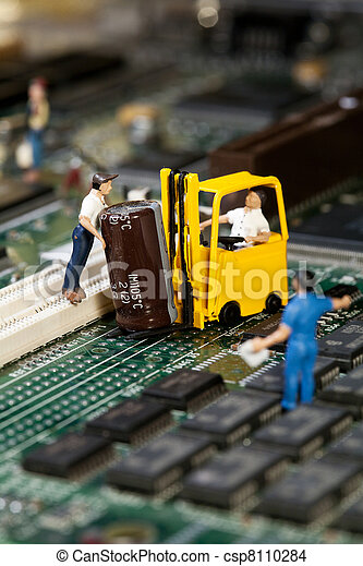Repairing Electronic Circuitry. A miniature model figurine of a welder at work on a circuit board, macro. - csp8110284