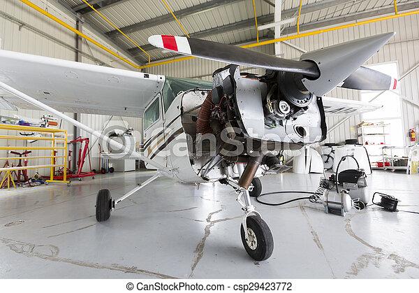 Repairing small propeller airplane - csp29423772