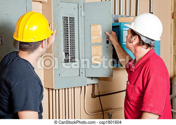 Repairmen Examine Electrical Panel - csp1801604