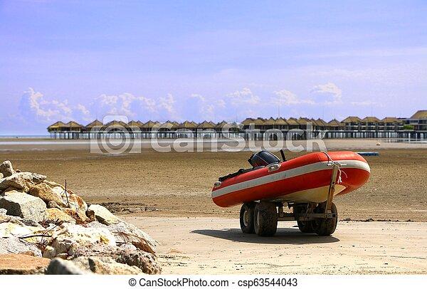 Rescue boat on the waterfront at Bagan Lalang beach - csp63544043