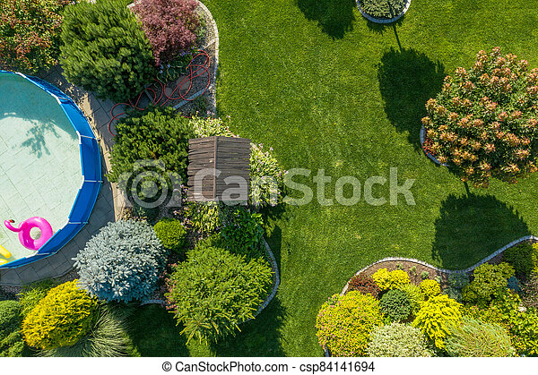 Residential Backyard Garden with Small Swimming Pool Aerial View - csp84141694