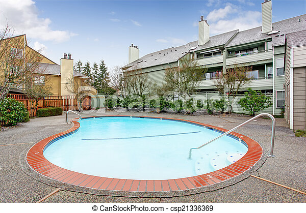 Residential building with swimming pool - csp21336369