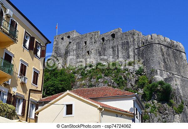 residential buildings on background of Forte Mare. showplace in Herceg Novi, Montenegro - csp74724062