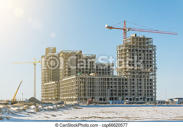 Residential complex real estate, under construction areas with high cranes - csp66620577