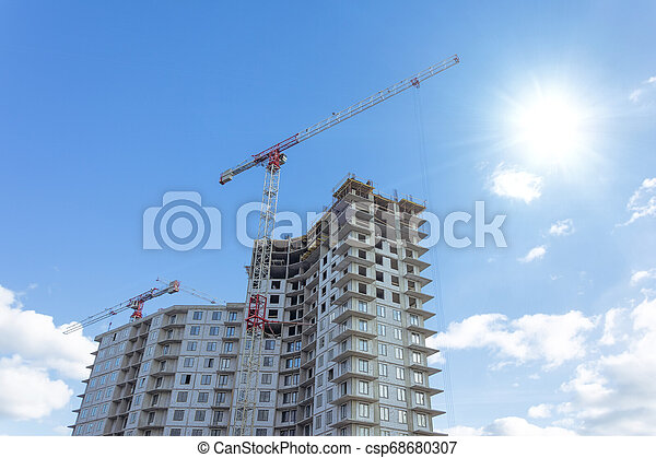 Residential complex real estate, under construction areas with high cranes - csp68680307