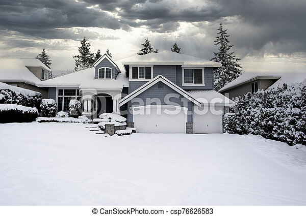 Residential home with snow - csp76626583