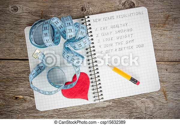 Resolutions written on a notepad - csp15632389
