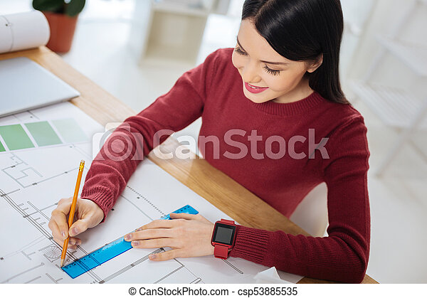 Drawing Lines With Photo Cs : Responsible engineer sitting and drawing the lines on her stock