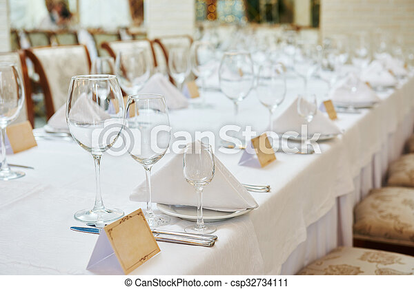 restaurant catering table with glassware  - csp32734111