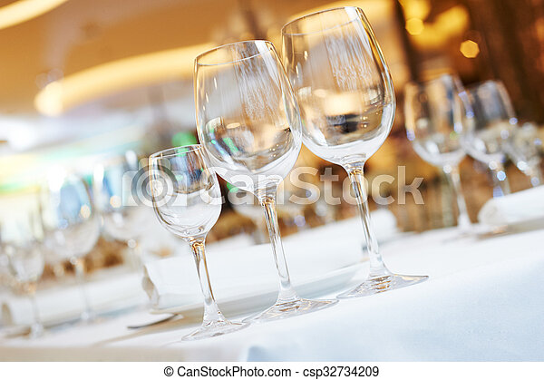 restaurant catering table with glassware  - csp32734209