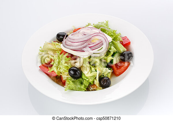 Restaurant food. Salad with bread in a plate. Delicious food. - csp50871210