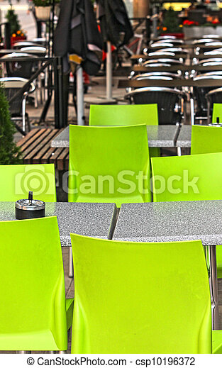 Restaurant outdoors with green chairs, nobody around - csp10196372