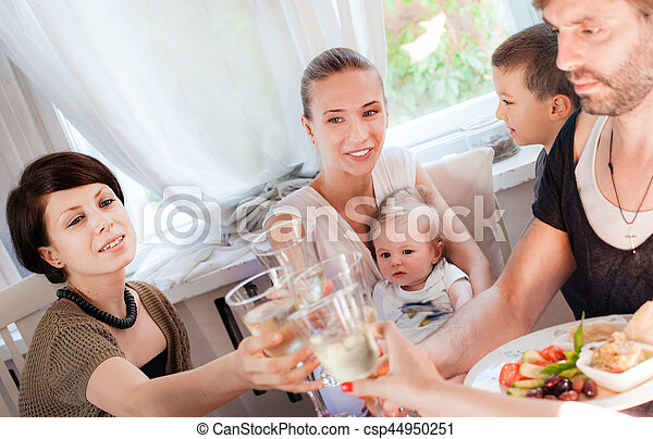 Restaurant toast friends young. - csp44950251