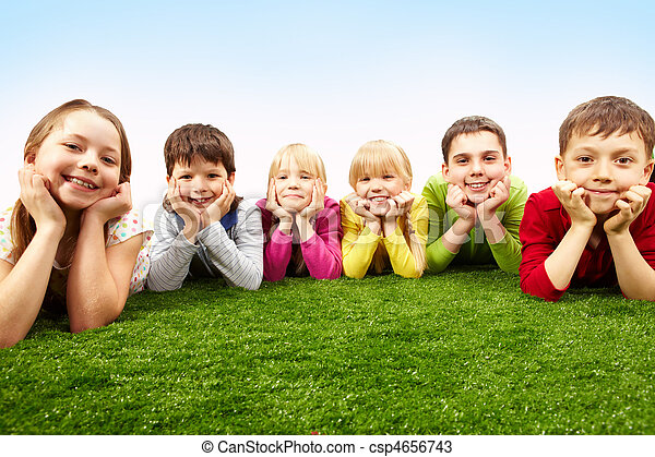 resting children image of happy boys and girls lying on a