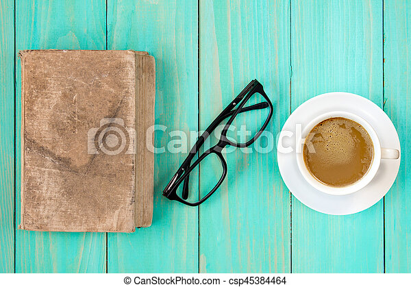 Resting time with book and coffee - csp45384464