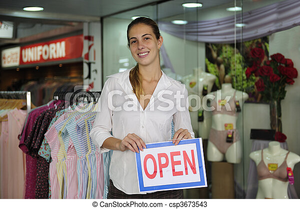 retail business: store owner with open sign - csp3673543