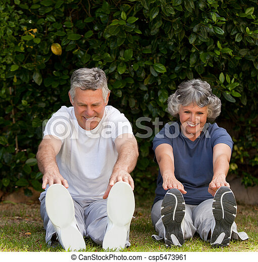Retired couple doing their exercises  - csp5473961