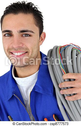 Retrato de un joven electricista - csp8777573