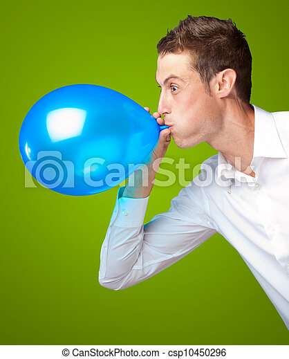 Retrato de joven soplando un globo - csp10450296
