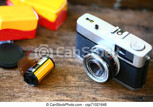 Retro camera with film for photography. Photographer love to take photo with old camera and film with feeling classic. The film camera not popular in present because digital camera instead. - csp71021648