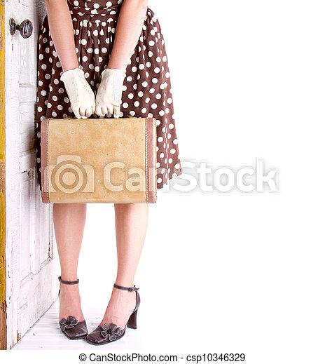 Retro image of woman holding luggage - csp10346329