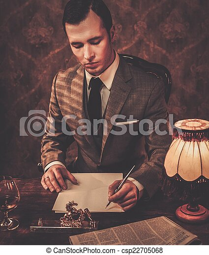 Retro man in grey suit holding a pen - csp22705068