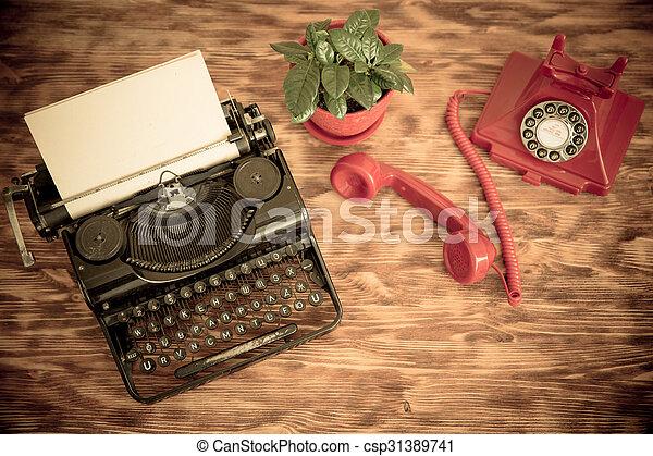 Retro phone and typewriter - csp31389741