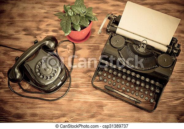 Retro phone and typewriter - csp31389737